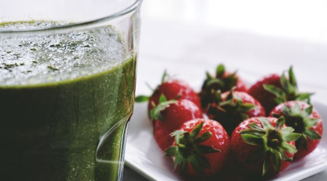 green smoothie and strawberries